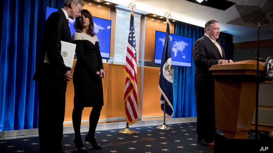 Secretary of State Mike Pompeo, right, accompanied by U.S. special representative on Iran Brian Hook, left, and State…