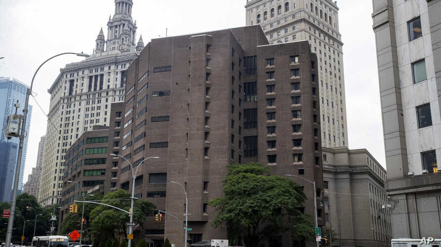 FILE - This Aug. 13, 2019, file photo, shows the Metropolitan Correctional Center in New York. Two correctional officers…