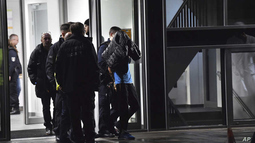 A man is arrested by the police at a hospital in Berlin, Germany, Nov. 19, 2019.
