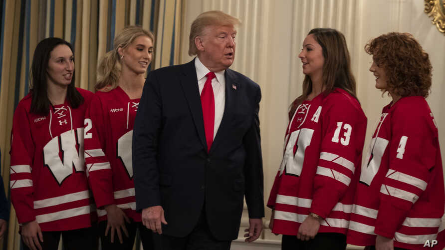 President Donald Trump talks with members of the University of Wisconsin-Madison Women's Hockey Team during the NCAA Collegiate…