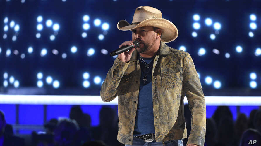 """FILE -  Jason Aldean performing """"Can't Hide Red"""" at the 54th annual Academy of Country Music Awards in Las Vegas,  April 7, 2019."""