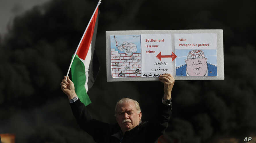 Palestinian hold poster depicting Israeli Prime Minister Benjamin Netanyahu, left, and US Secretary of State Mike Pompeo as…