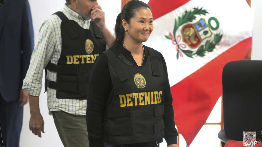 """FILE - Keiko Fujimori, the daughter of Peru's former President Alberto Fujimori, and leader of the opposition party, enters to the courtroom wearing a chest vest that reads in Spanish: """"Detained"""" in Lima, Peru, Oct. 17, 2018."""