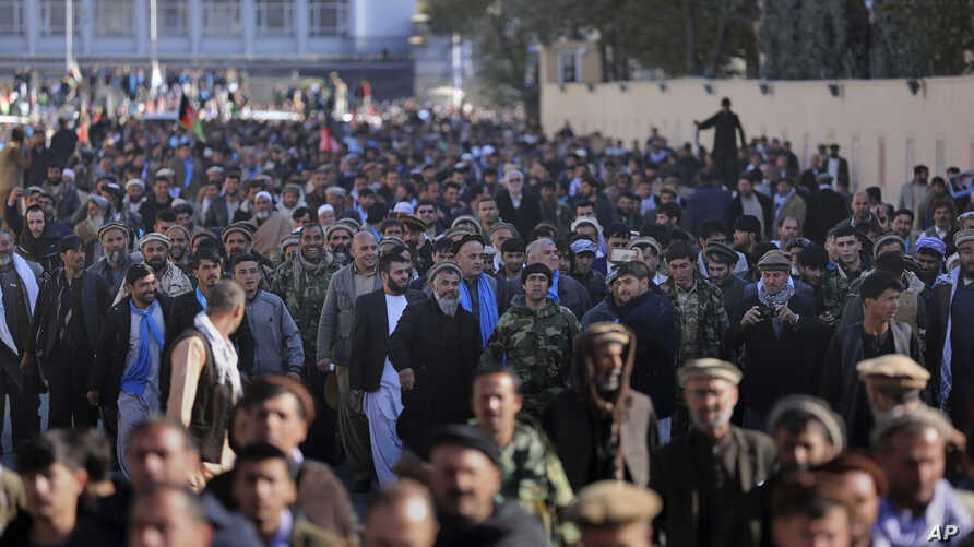 Supporters of Afghanistan's leading presidential candidate, Abdullah Abdullah, march during a mass demonstration in Kabul, Afghanistan, ov. 29, 2019.