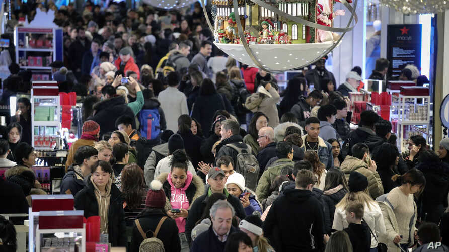 People shop at Macy's department store during Black Friday shopping, Friday Nov. 29, 2019, in New York. Black Friday shoppers…