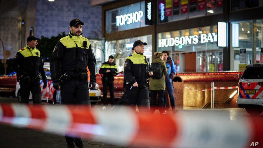 Dutch police secure a shopping street after a stabbing incident in the center of The Hague, Netherlands, Friday, Nov. 29, 2019…