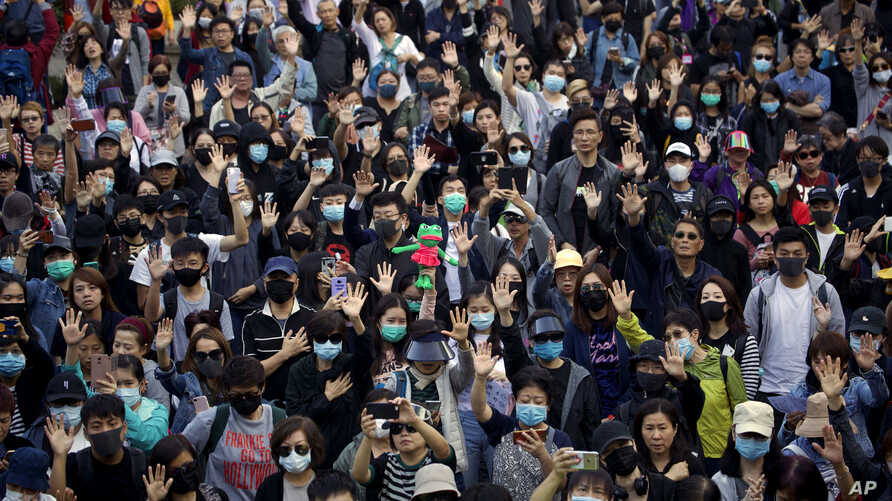 Protesters raise their hand to symbolize the five demands of the pro-democracy movement during a rally for young and elderly…