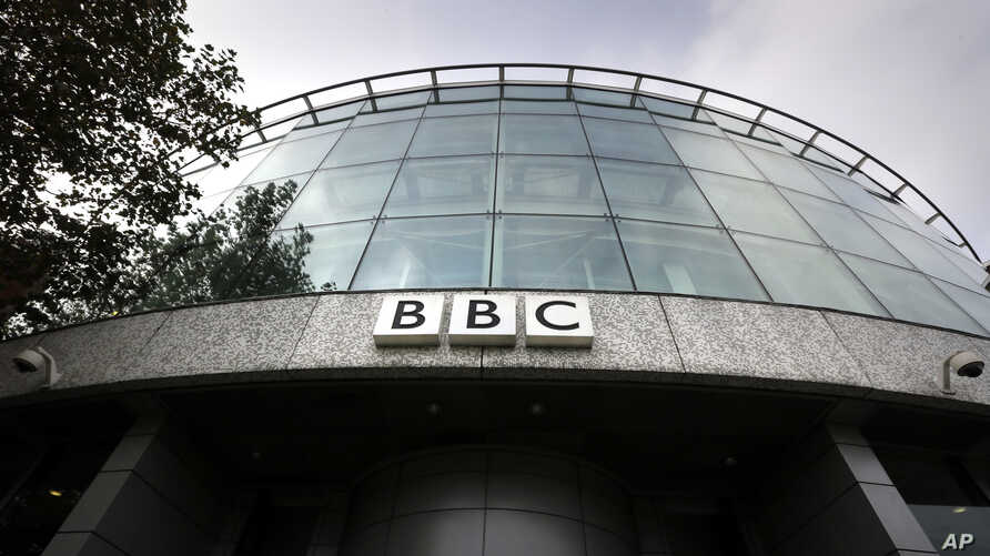 FILE - In this Oct. 24, 2012 file photo, a sign is seen at the entrance to a building at the BBC Television Centre, in London …