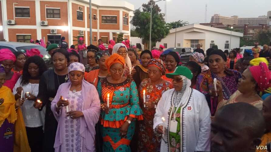 Nigerian women participate in a candlelight procession to remember victims of sexual violence in Abuja, Nigeria, Nov. 25, 2019. (Timothy Obiezu/VOA)