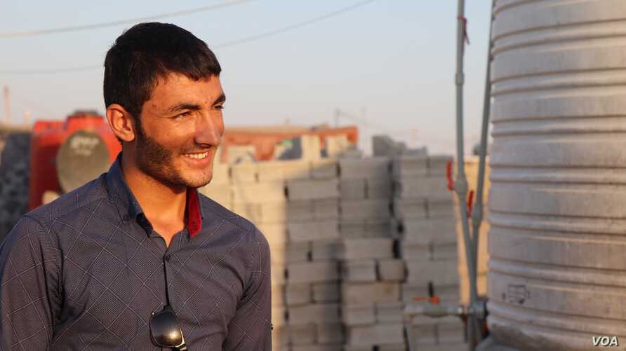 Daoud, 19, was kidnapped when he was 15-years-old and forced to fight with IS before he was rescued in August, pictured on Sept. 29, 2019 in Khanke, Kurdistan Region, Iraq. (Heather Murdock/VOA)