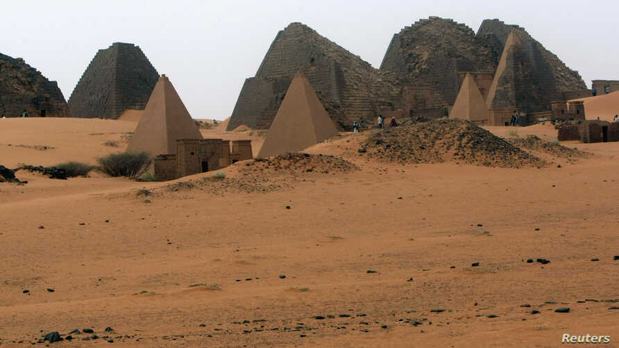Tourists explore 44 Nubian pyramids of kings and queens in the ruins of the ancient city of Meroe next to Begrawiya, in the River Nile state of Sudan, March, 10, 2012.