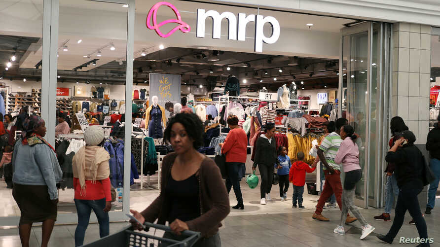 Shoppers walk past South Africa's Mr Price clothing store in Johannesburg, South Africa, May 31, 2019. REUTERS/Siphiwe Sibeko -…