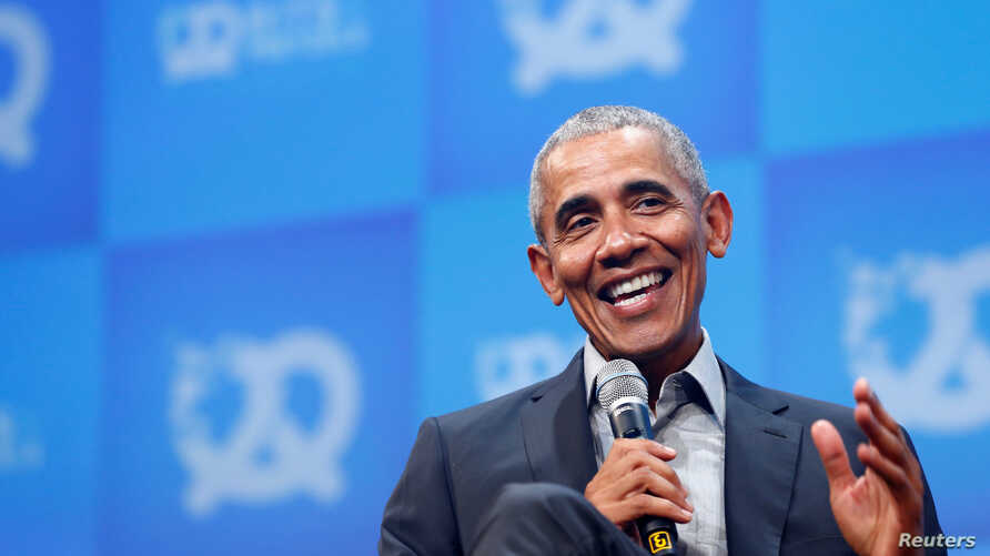 Former U.S. President Barack Obama takes part in a moderated discussion during the opening of the Bits & Pretzels tech start-up…