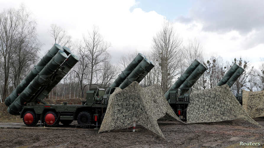 """FILE PHOTO: A new S-400 """"Triumph"""" surface-to-air missile system after its deployment at a military base outside the town of…"""