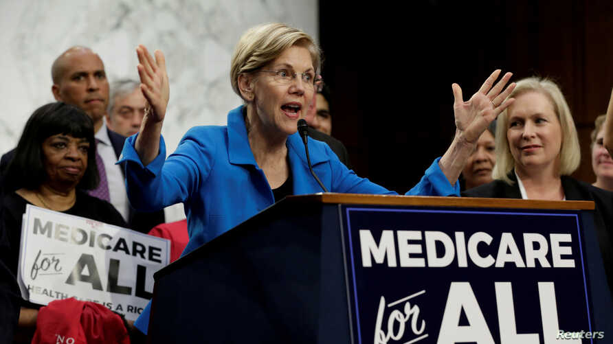 """FILE PHOTO: Senator Elizabeth Warren (D-MA) speaks during an event to introduce the """"Medicare for All Act of 2017"""" on Capitol…"""