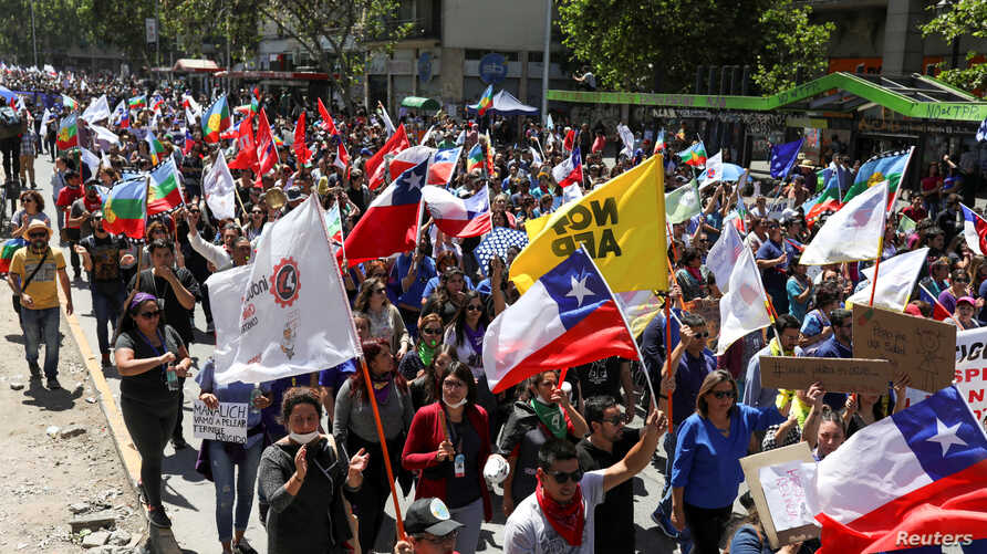 Workers take part in a national strike during ongoing protests against Chile's government, in Santiago Chile November 26, 2019…