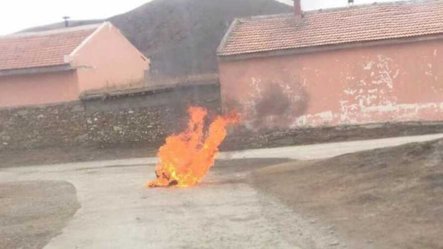 A Tibetan man named Youten sets himself on fire in a village in Meruma township, Ngaba (in Chinese, Aba) county, a Tibetan region in the western Chinese province of Sichuan, Nov. 26, 2019.