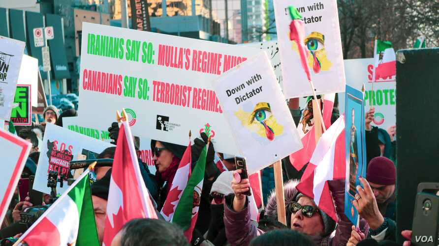 Several hundred people attend a rally in solidarity with recent anti-government protests in Iran, in Toronto, Canada, Nov. 24, 2