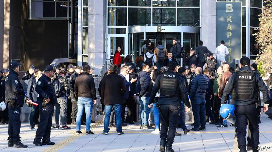 People arrive at a courthouse to attend the trial of eighteen students and a lecturer allegedly involved in a banned LGBTI pride event, in Ankara, Turkey, Nov. 12, 2019.