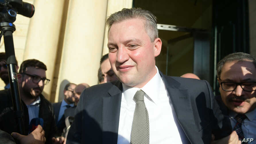 Malta's outgoing Tourism minister Konrad Mizzi leaves the office of the Prime Minister in Valletta, announcing his resignation from his post following a parliamentary meeting, Nov. 26, 2019.
