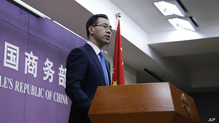 FILE - Chinese Ministry of Commerce spokesman Gao Feng speaks during a press conference at the ministry, in Beijing, China, April 6, 2018.