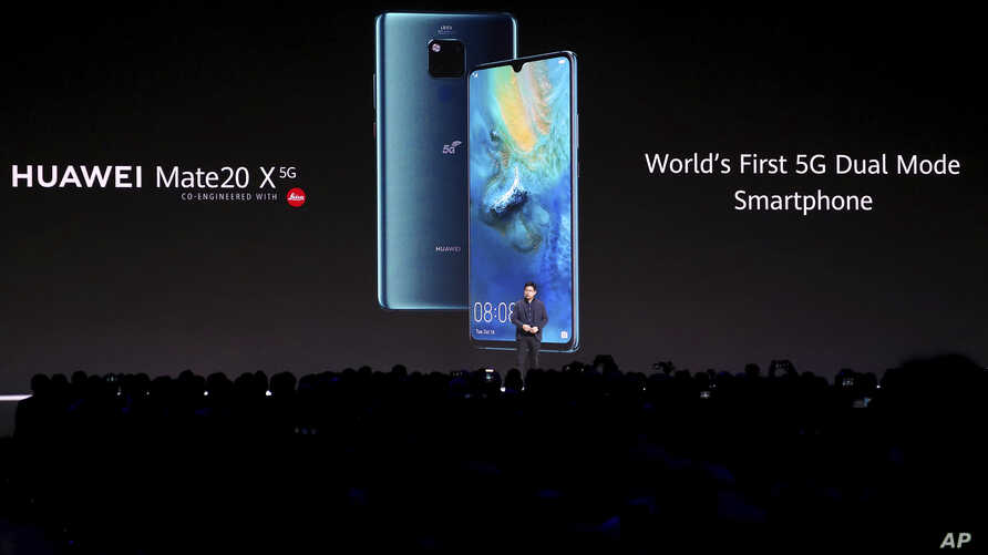 FILE - Richard Yu, CEO of the Huawei consumer business group, presents new devices during an event in Munich, Germany, Sept. 19, 2019.