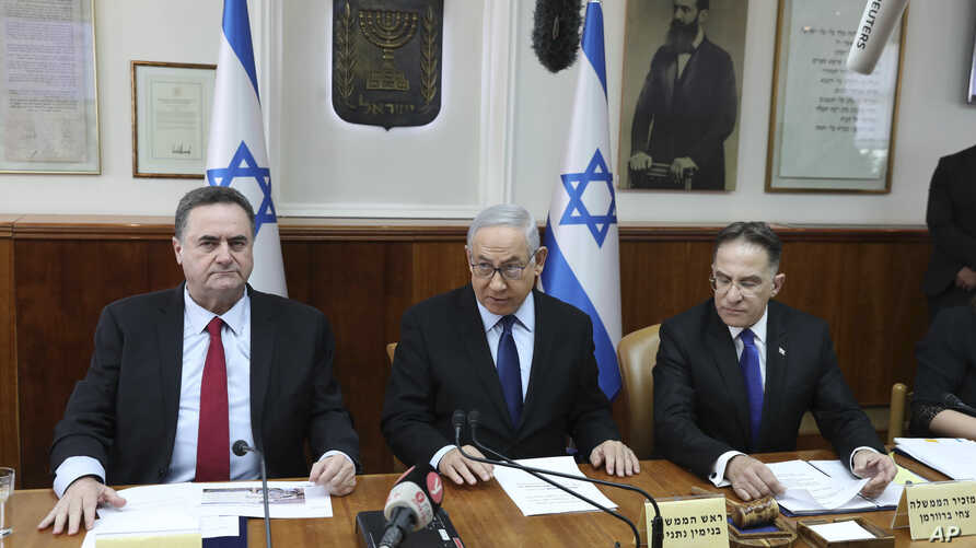 Israeli Prime Minister Benjamin Netanyahu center, Foreign Minister Israel Katz, left, and the government secretary Tzachi Braverman, attend the weekly cabinet meeting at the Prime Minister's office in Jerusalem, Nov. 10, 2019.