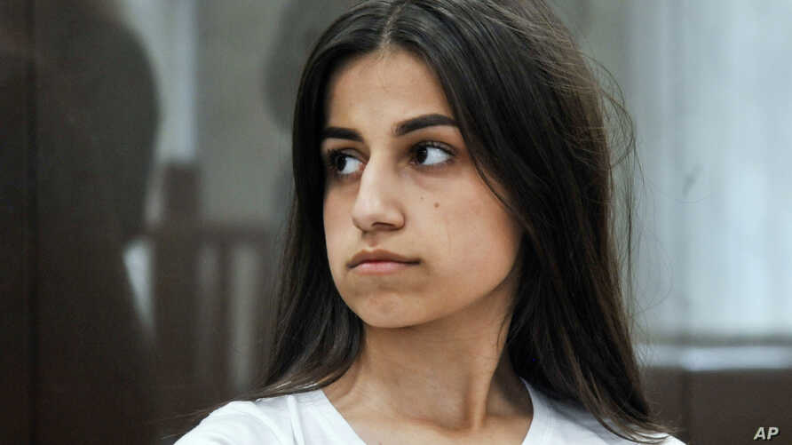 FILE - Angelina Khachaturyan attends a court hearing in Moscow, Russia, June 26, 2019. She and her two sisters are accused of murdering their father who, investigators confirmed, abused them for years.