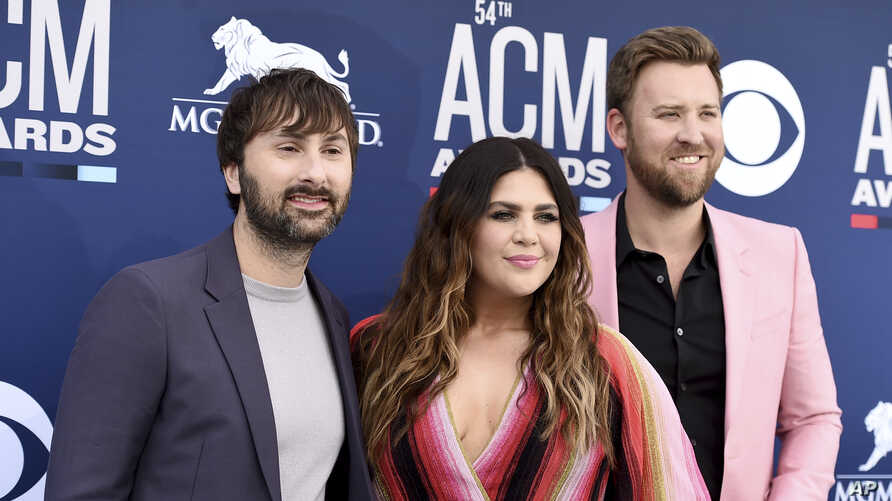 Dave Haywood, from left, Hillary Scott and Charles Kelley, of Lady Antebellum, arrive at the 54th annual Academy of Country Music Awards at the MGM Grand Garden Arena, April 7, 2019, in Las Vegas.