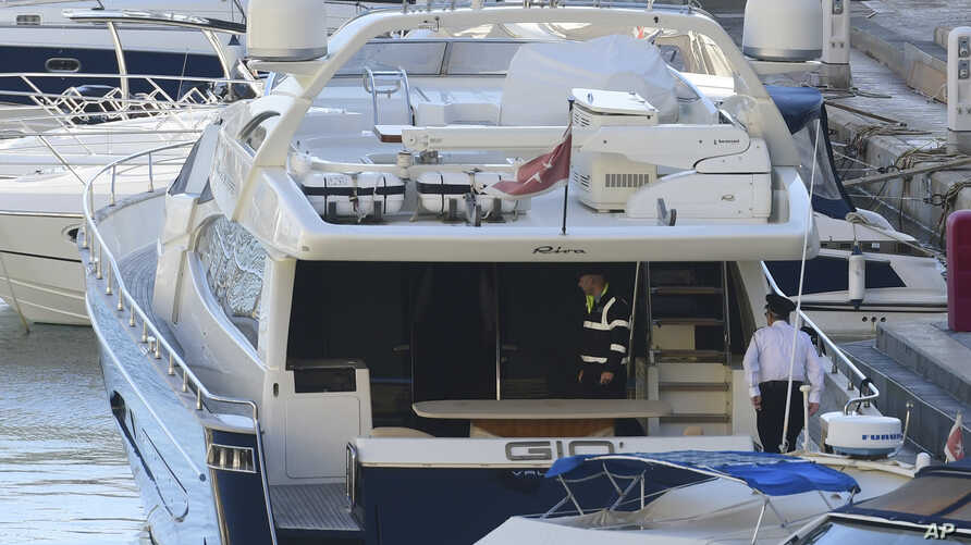 "Police aboard the yacht ""Gio"" after it was intercepted on a course for Sicily by the Maltese military, Nov. 20, 2019, and forced back to Portomaso."