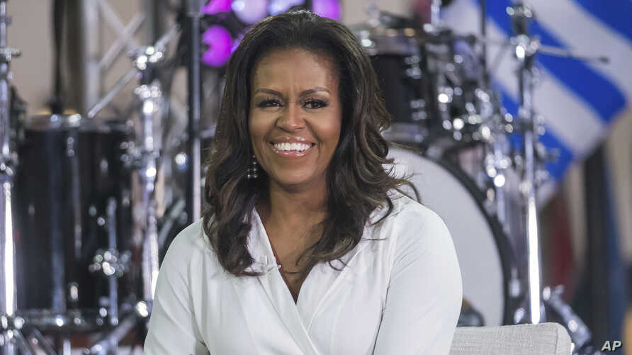"""FILE - Michelle Obama participates in the International Day of the Girl on NBC's """"Today"""" show in New York, Oct. 11, 2018."""