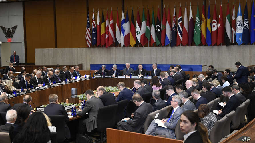 U.S. Secretary of State Mike Pompeo (C) speaks as he is joined by other foreign ministers and officials at the State Department in Washington, Nov. 14, 2019, at a global coalition to defeat the Islamic State meeting.