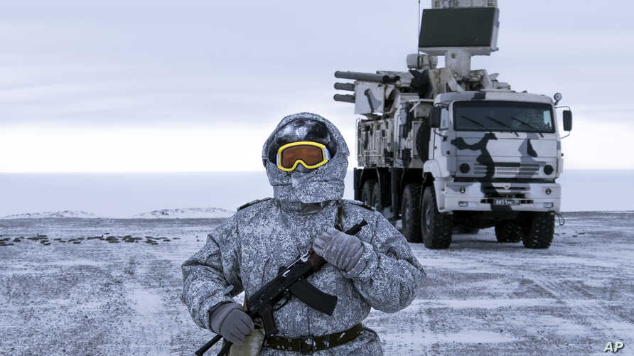 FIEL - A Russian solder stands guard as Pansyr-S1 air defense system on the Kotelny Island, part of the New Siberian Islands archipelago located between the Laptev Sea and the East Siberian Sea, April 3, 2019.