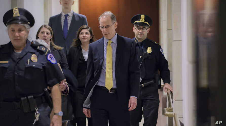 Mark Sandy, a career official in the White House Office of Management and Budget, arrives at the Capitol to testify in the House Democrats' impeachment inquiry  against President Donald Trump, in Washington, Nov. 16, 2019.