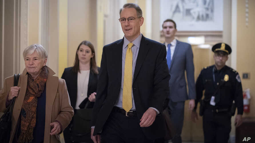 Mark Sandy, with the White House Office of Management and Budget, arrives at the Capitol to testify in the House impeachment inquiry about President Donald Trump's effort to tie military aid for Ukraine to probes of political opponents, Nov. 16, 2019.