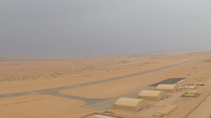 Hangars and an airstrip are seen at a new U.S.-constructed air base at a remote desert location in Niger (screengrab from U.S. Department of Defense video)