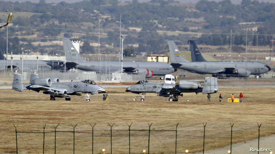 FILE - U.S. Air Force A-10 Thunderbolt II fighter jets (foreground) are pictured at Incirlik Air Base, near Adana, Turkey, Dec. 11, 2015.