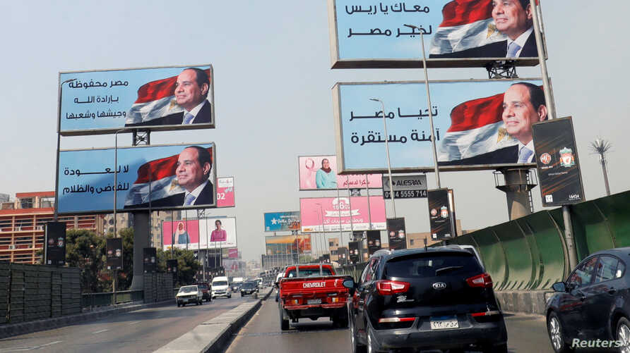 FILE - Cars move along the '6th October Bridge' lined with banners of Egyptian President Abdel Fattah el-Sissi, in Cairo, Egypt, Oct. 2, 2019.