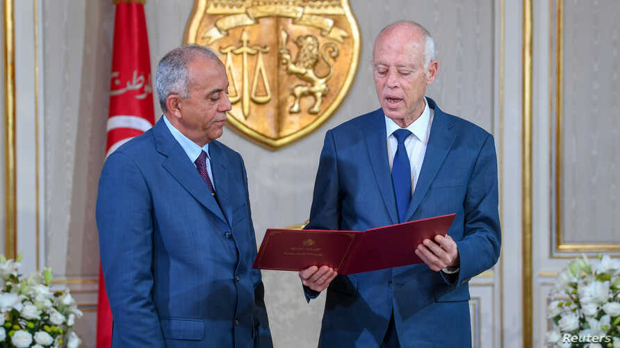 Tunisian President Kais Saied (L) meets with Prime Minister-designate Habib Jemli in Tunis, Tunisia, in this handout picture obtained by Reuters from the Tunisian Presidency, Nov. 15, 2019.