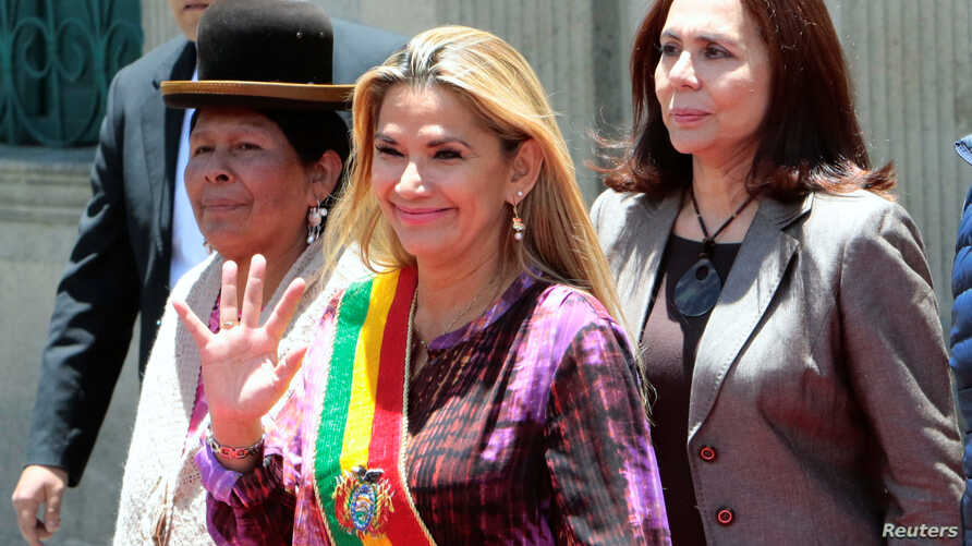 Bolivia's interim president Jeanine Anez (C), new Minister of Culture Martha Yujra (L) and new Foreign Minister Karen Longaric attend a ceremony in La Paz, Bolivia, Nov. 18, 2019.