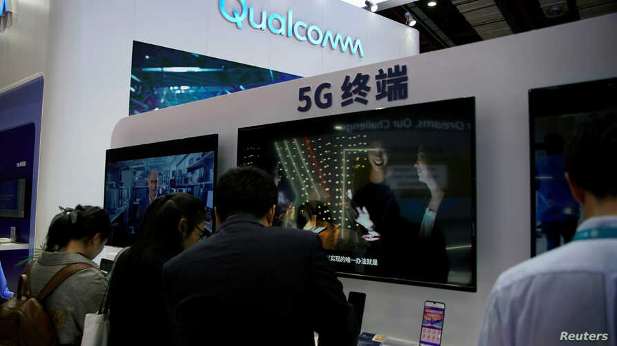 A Qualcomm sign is seen at the 2ns China International Import Expo (CIIE) in Shanghai, Nov. 6, 2019.