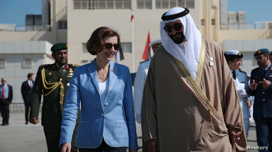 French Defence Minister Florence Parly and United Arab Emirates' Minister of State for Defence Mohammed Bin Ahmad al-Bawardi speak during a military ceremony at the French Naval Base in Abu Dhabi, UAE, Nov. 24, 2019.