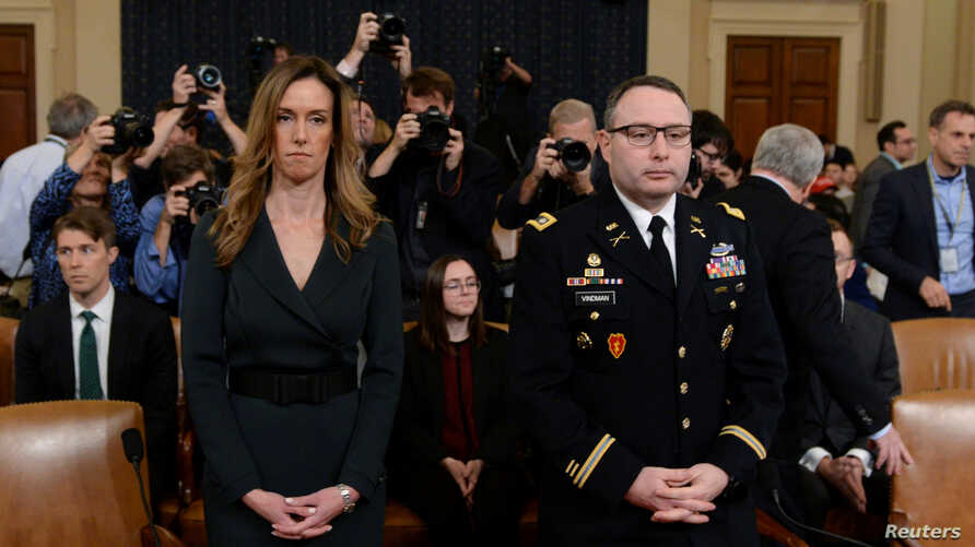 Jennifer Williams, special adviser to Vice President Mike Pence and Lt. Colonel Alexander Vindman, director for European Affairs at the National Security Council, prepare to testify before the House Intelligence Committee, Nov. 19, 2019.