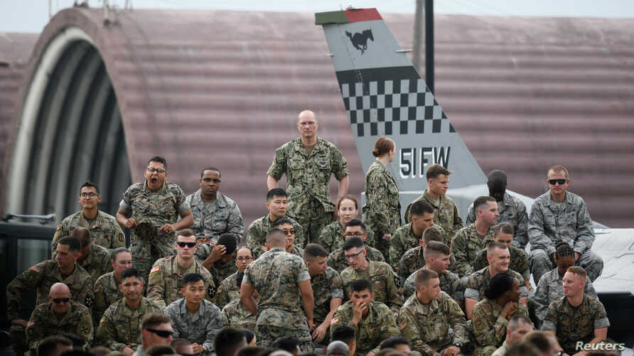 FILE - U.S. soldiers wait for a speech by U.S. President Donald Trump (not pictured) in Osan Air Base, South Korea, June 30, 2019.