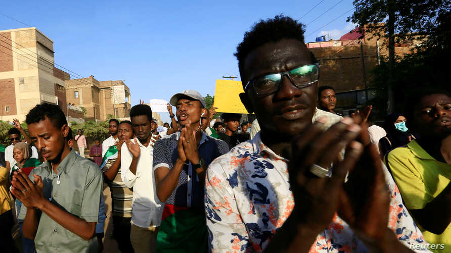 Sudanese protesters chant slogans during a rally calling for the former ruling party to be dissolved and for ex-officials to be put on trial in Khartoum, Oct. 21, 2019.