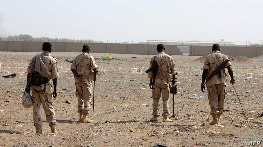 Sudanese troops with a military coalition in Yemen backed by Saudi Arabia and the United Arab Emirates detect mines at a…