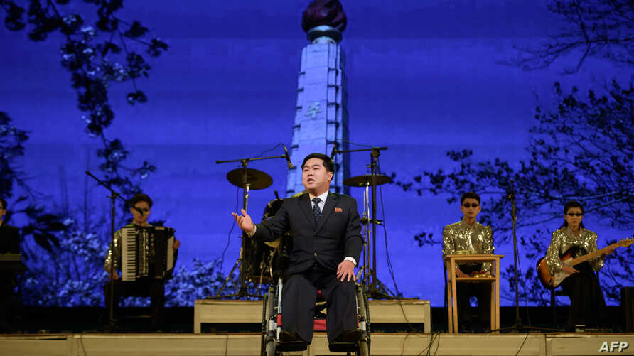 In a photo taken on December 3, 2019 paraplegic Ri Guk Chol, 35, performs during an event to mark the International Day of…