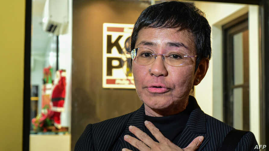 Maria Ressa, co-founder and CEO of the Philippines-based news website Rappler, speaks to members of the media as she leaves…