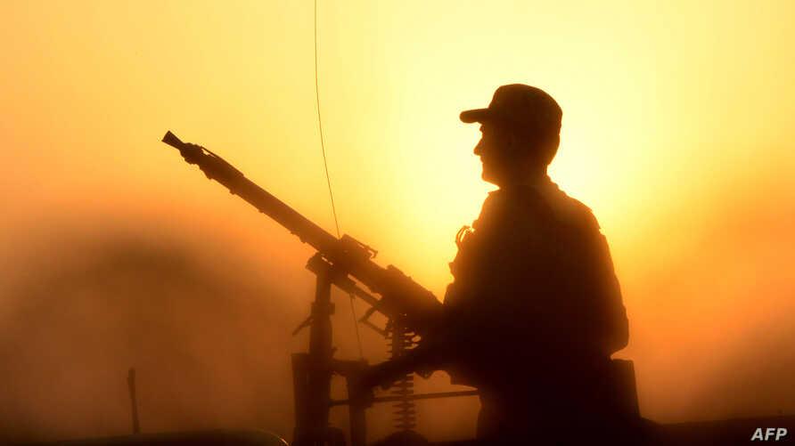 A Pakistani army soldier stand guards during a search operation against militants on the outskirts of Peshawar on June 24, 2017…
