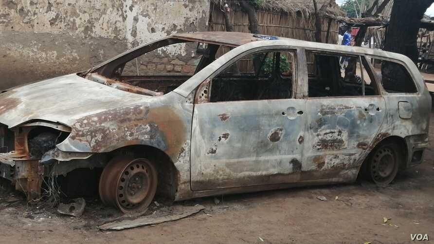 FILE - A burnt motor viehicle is seen following post-election violence in Lilongwe, Oct. 8, 2019. (Lameck Masina/VOA)